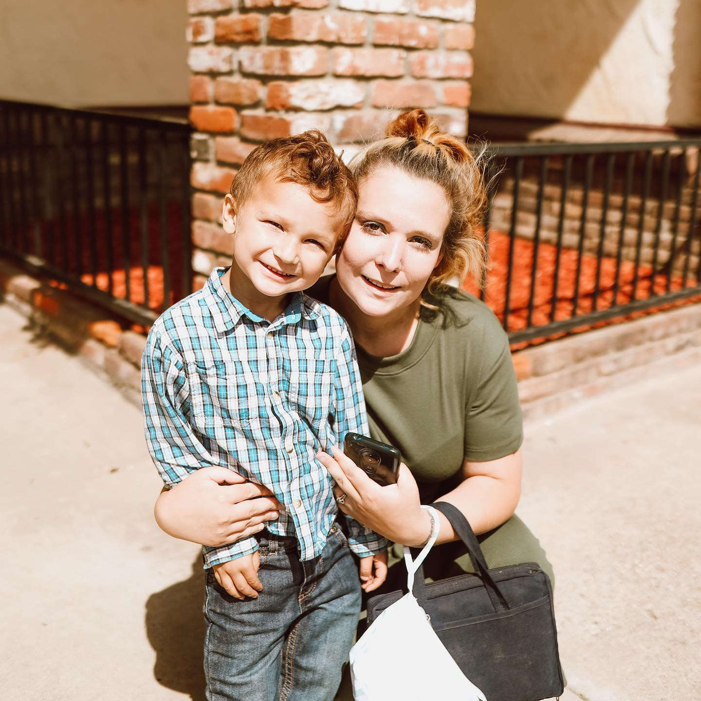 A child and his mom smiling at Bible Baptist Church